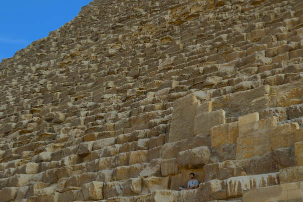 Great pyramid and man meditating